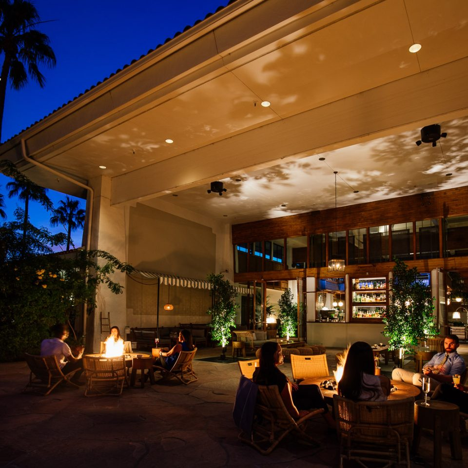 outdoor hangout spot at night at The Scott Resort & Spa