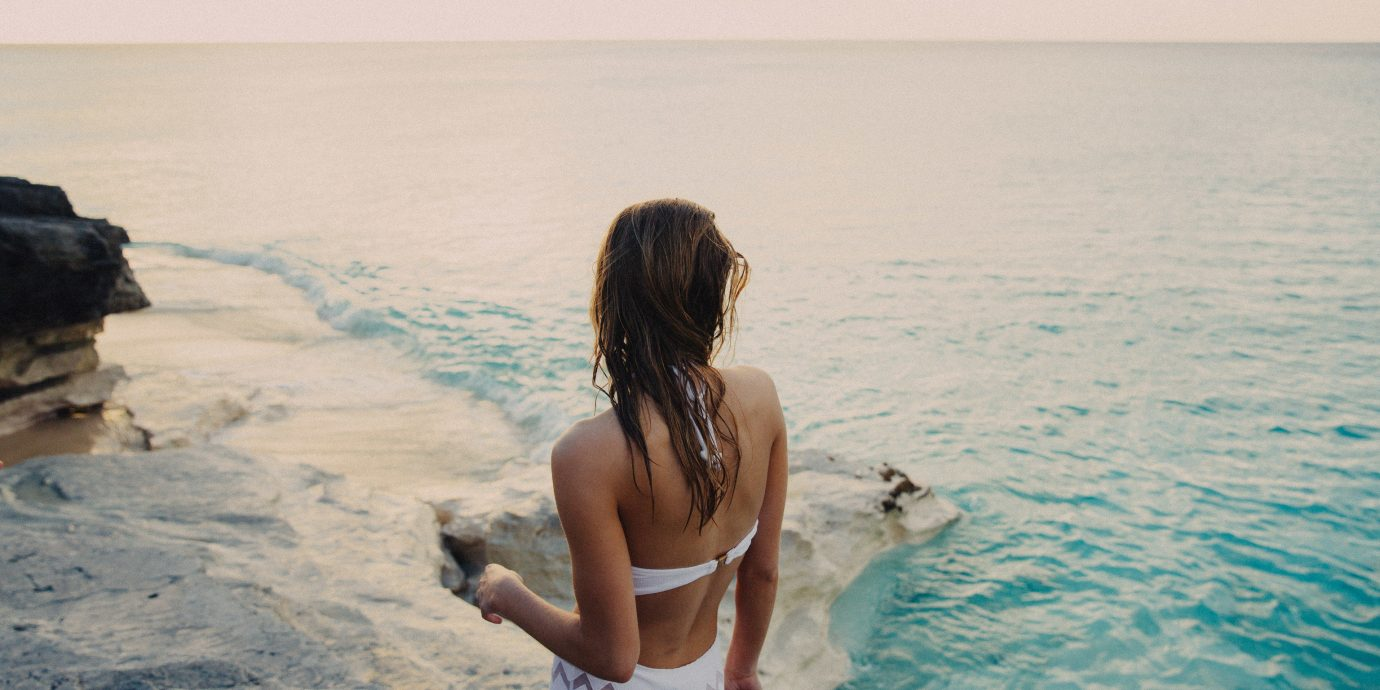 Giveaway Style + Design water outdoor person Sea photograph body of water vacation girl Ocean Beauty Beach swimwear fun summer photography shore sky coastal and oceanic landforms wave horizon sunlight leisure tourism sand back Coast rock swimming
