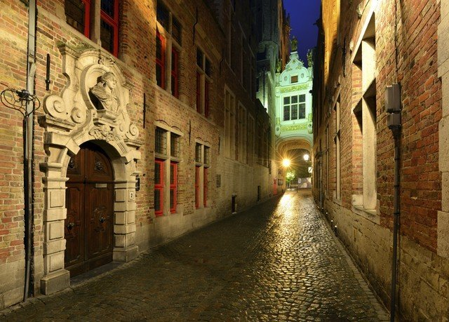 building way color alley scene road sidewalk Town street brick night infrastructure lighting ancient history evening middle ages waterway arcade stone