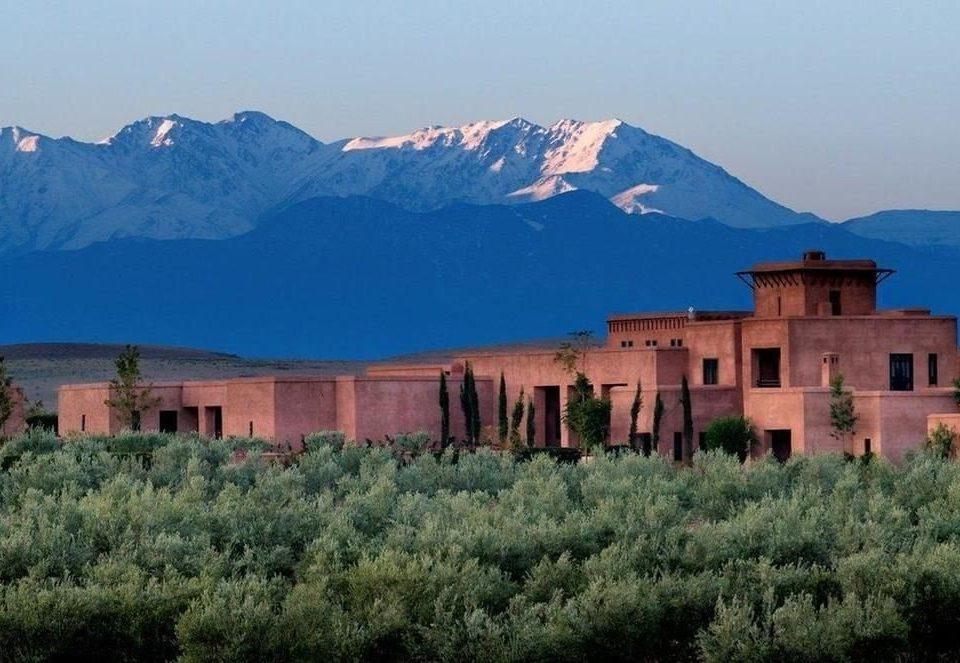 sky mountain mountainous landforms background Town mountain range valley monastery panorama distance lush