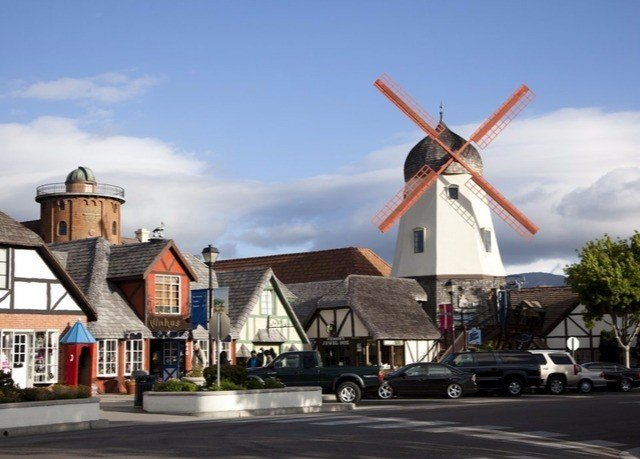 sky road mill house windmill street building outdoor object wind Town machine residential