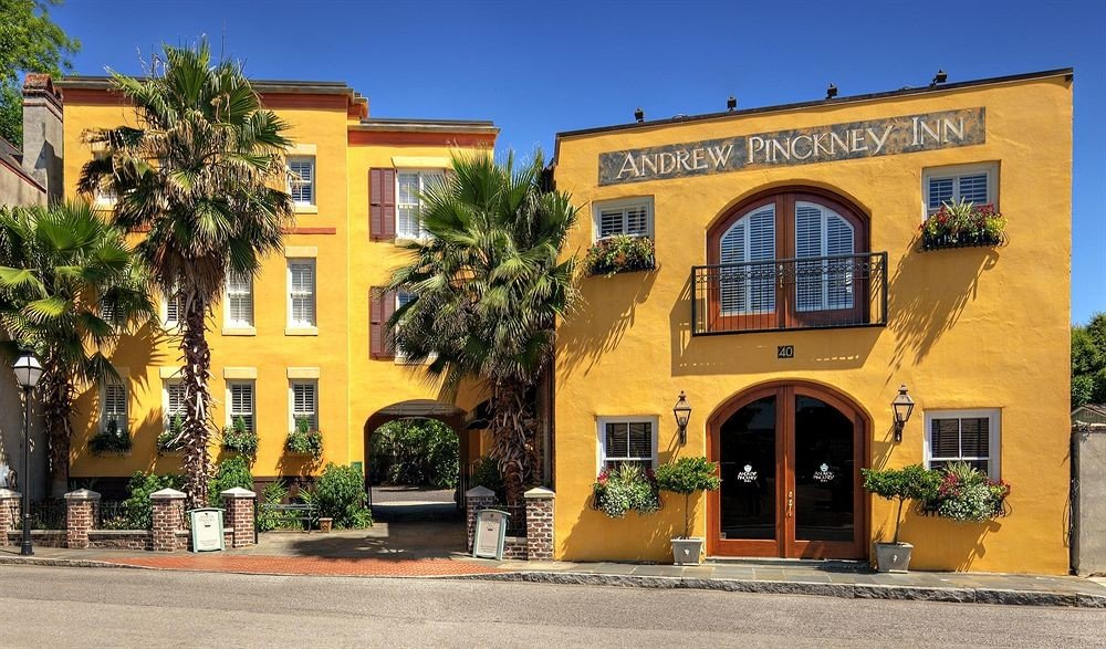 property building Town neighbourhood yellow home hacienda Villa curb
