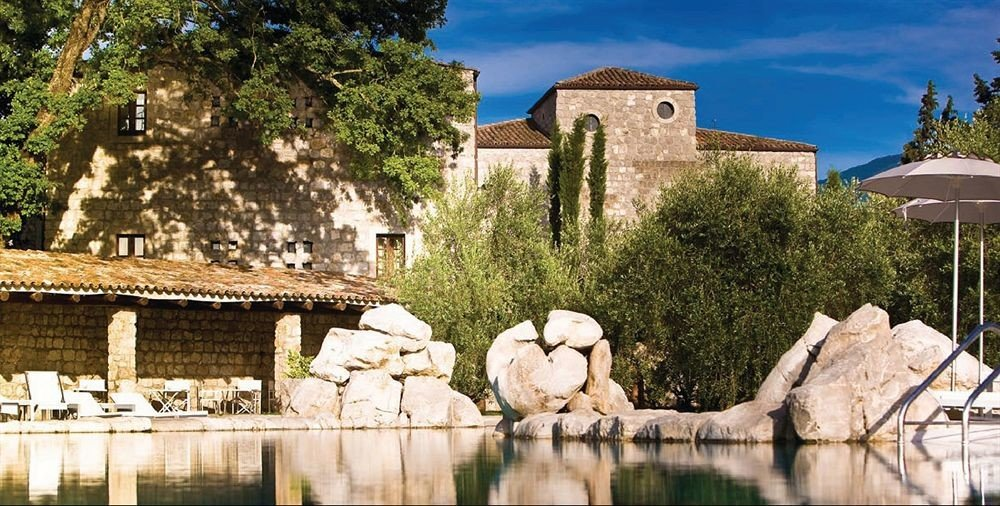 tree building Town Village monastery ancient history château place of worship Villa tours stone