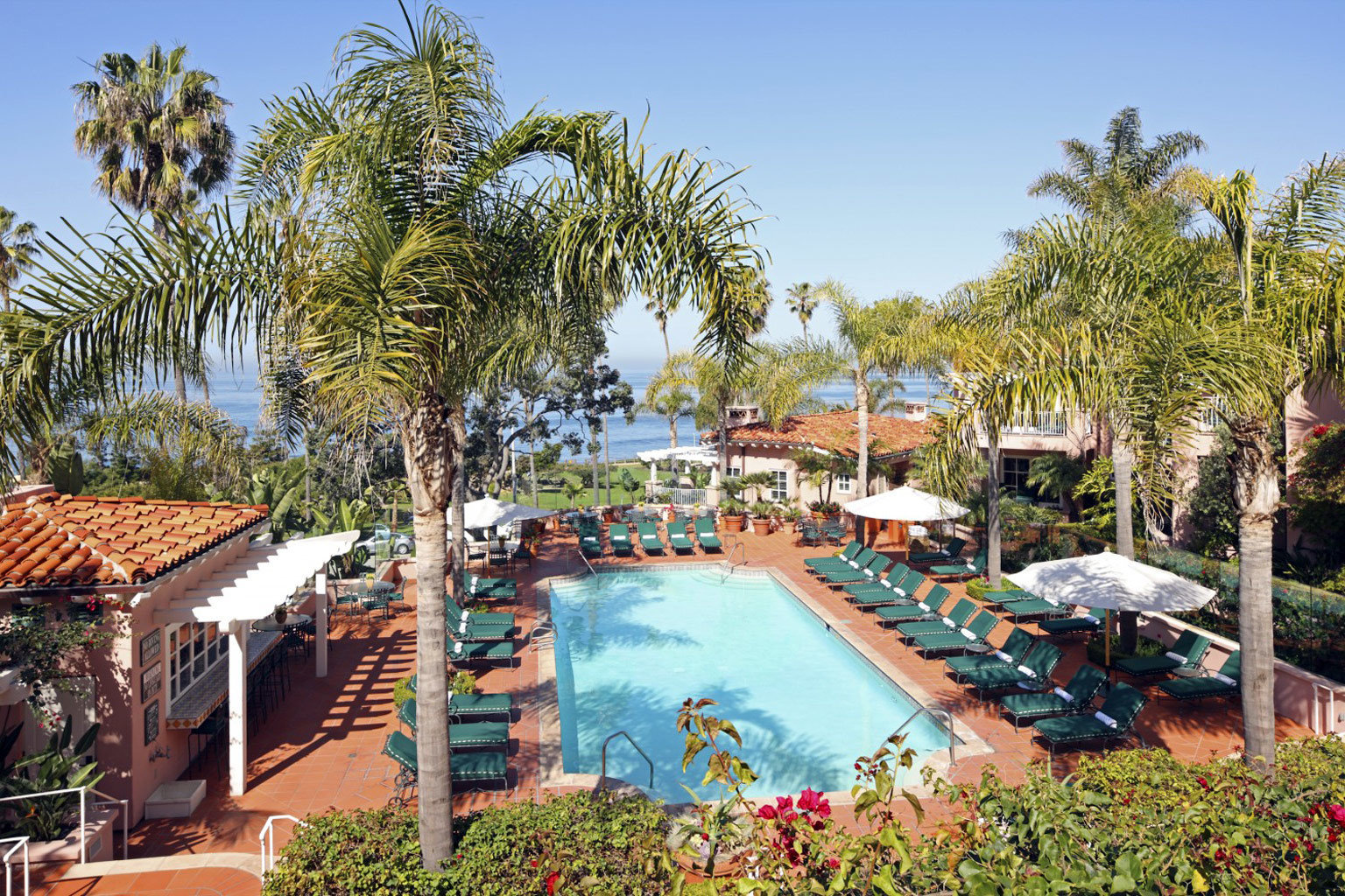 Elegant Hotels Luxury Patio Pool Tropical tree outdoor sky Resort leisure palm building vacation estate arecales Garden Village plant Water park amusement park swimming pool area several