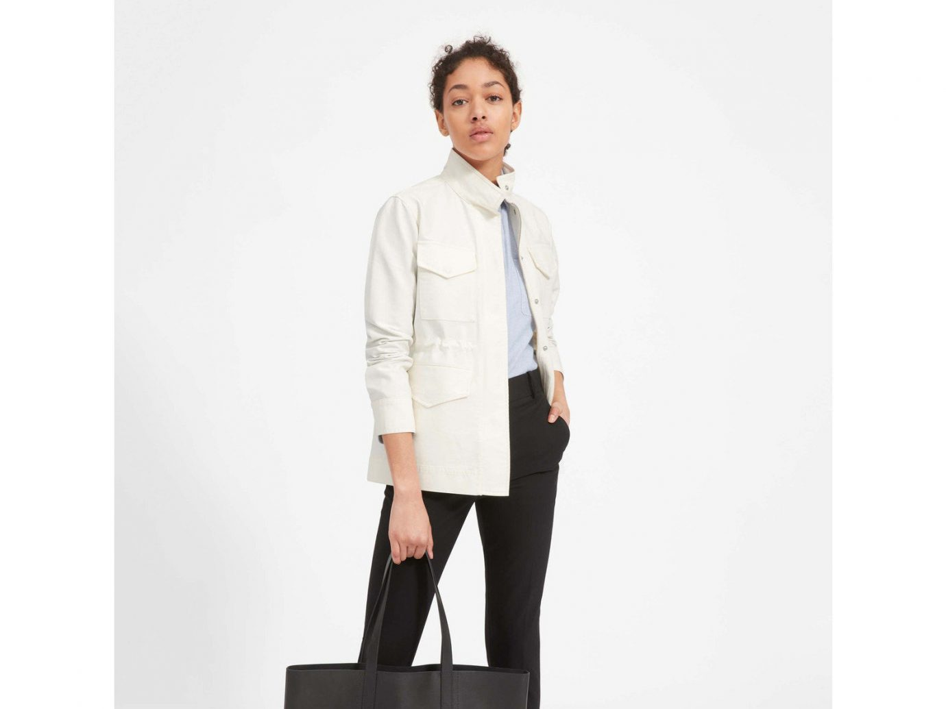 Packing Tips Spring Travel Style + Design Travel Shop standing person posing clothing suit wearing fashion model formal wear outerwear coat dressed jacket beige professional gentleman sleeve top trouser clothes