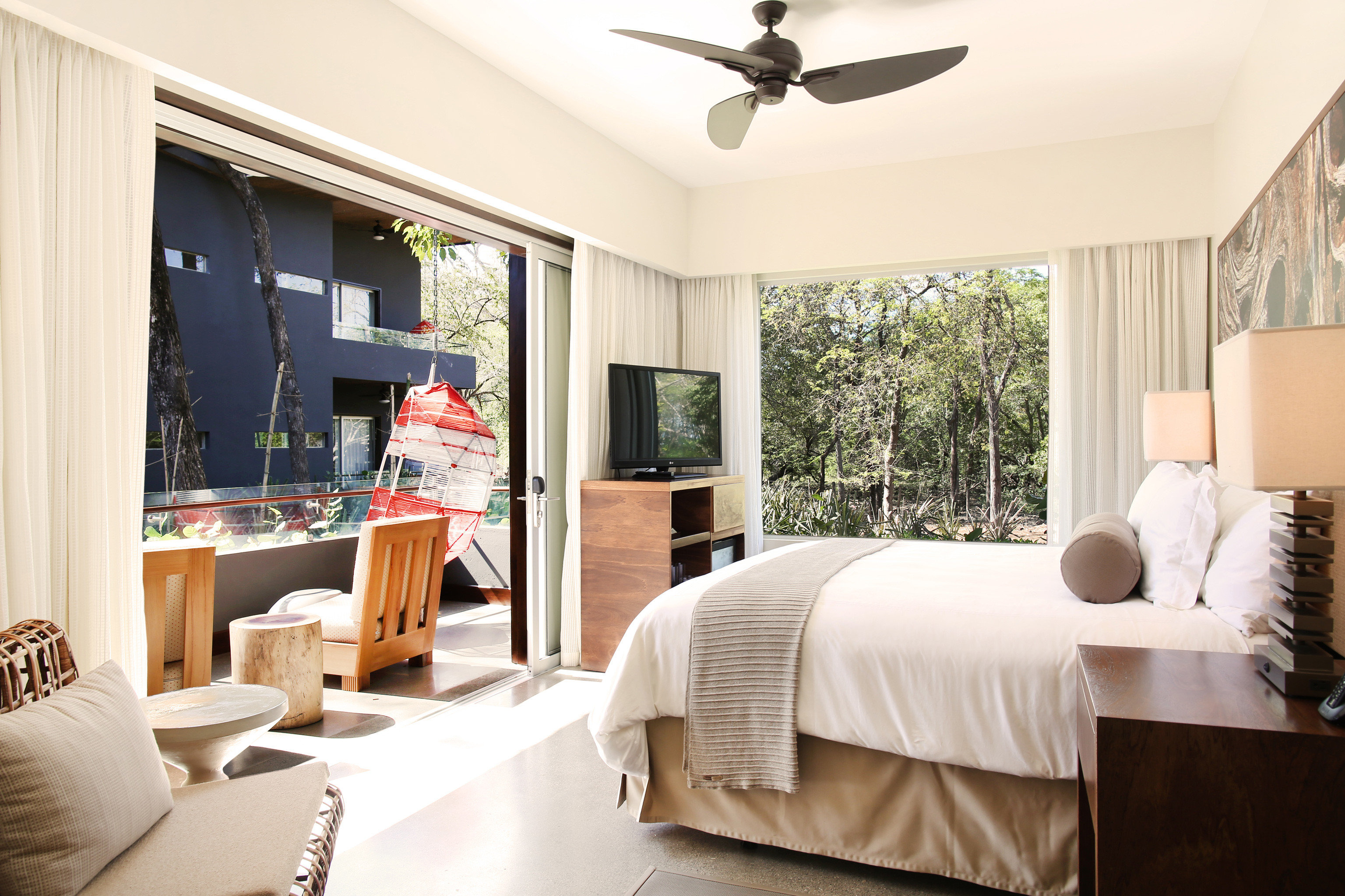 Balcony Beachfront Bedroom Boutique Elegant Hip Hotels Scenic views Suite Waterfront indoor bed sofa room wall window ceiling hotel floor property living room home estate interior design real estate cottage Villa decorated furniture flat