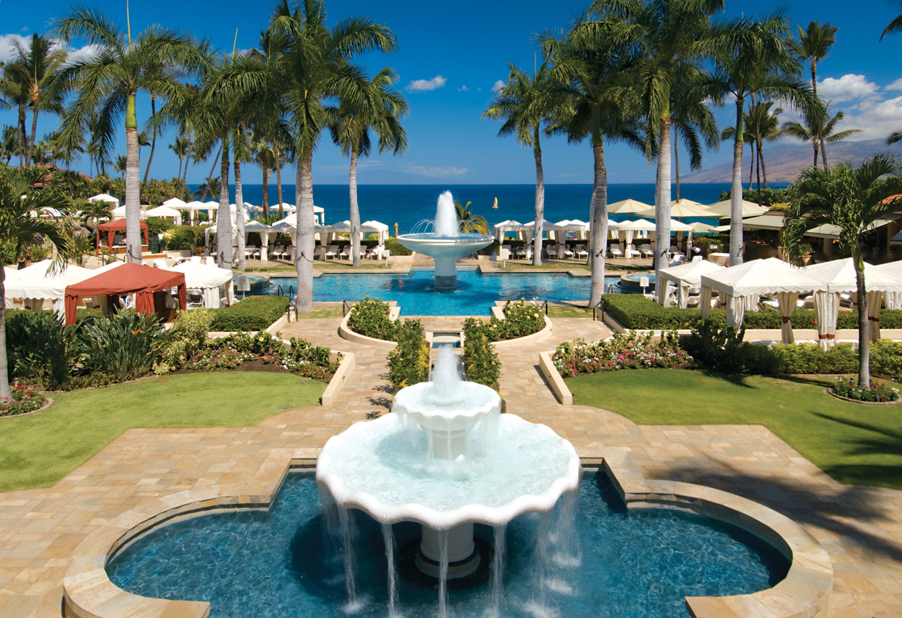 Beach Boutique Hotels Grounds Hotels Island Luxury Travel Patio Pool Tropical tree outdoor sky grass palm Resort swimming pool leisure estate vacation park Golf resort town Garden Water park mansion palace Villa caribbean plant shade
