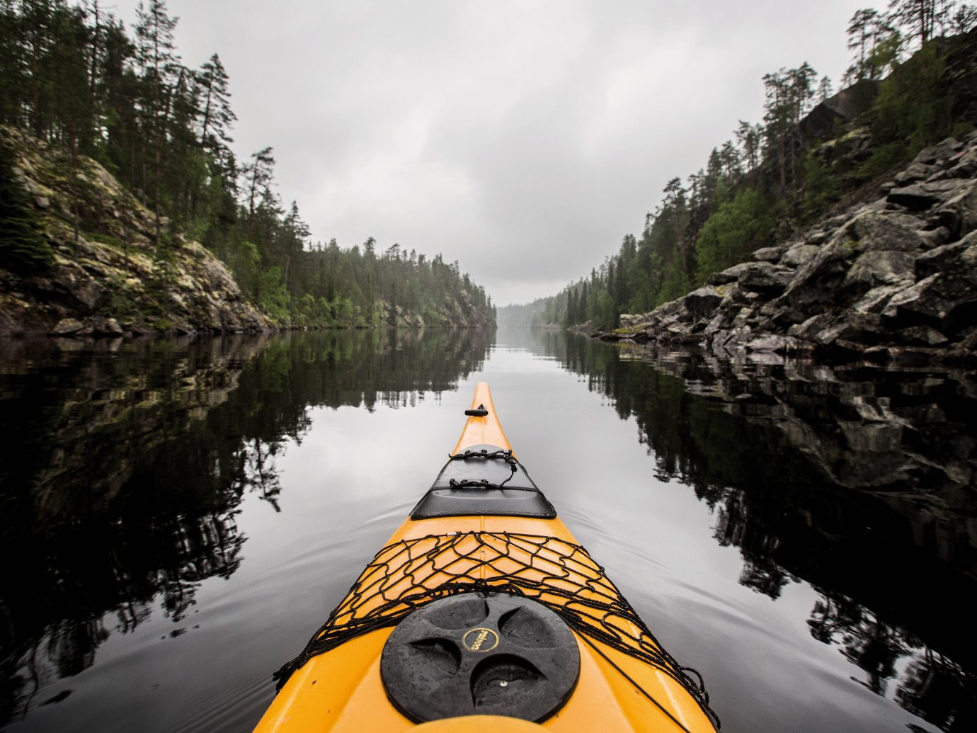 Trip Ideas outdoor tree Boat vehicle kayaking kayak boating yellow mountain rock River watercraft sports equipment canoe Nature extreme sport rapid paddle traveling hillside