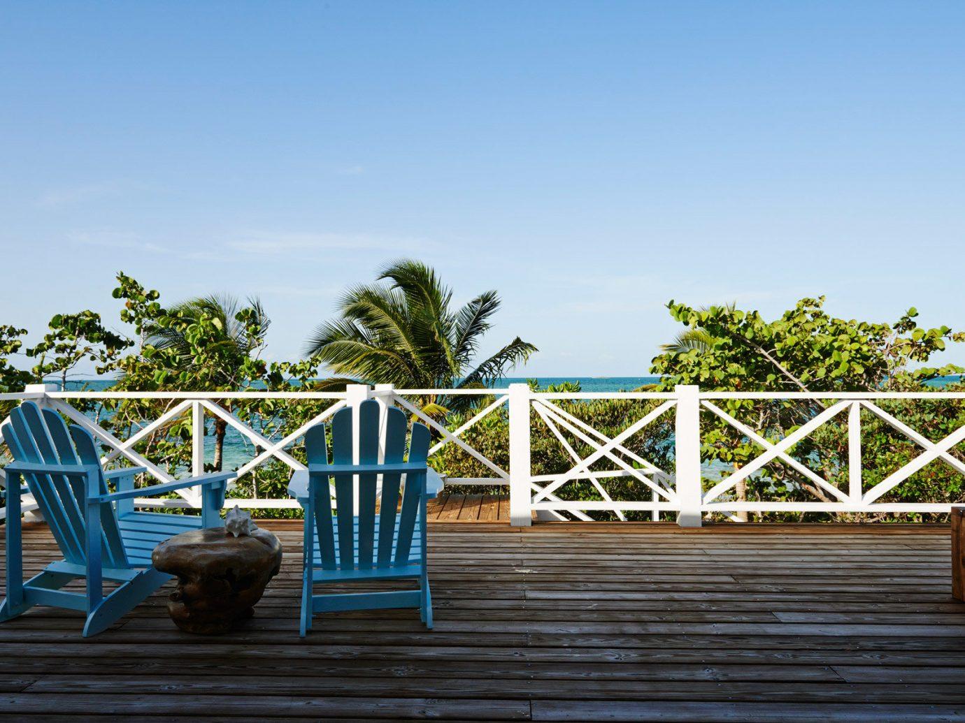 Beachfront Deck Hotels Luxury Patio Resort Romance Scenic views outdoor sky tree building walkway bridge wooden vacation estate wood boardwalk Beach day