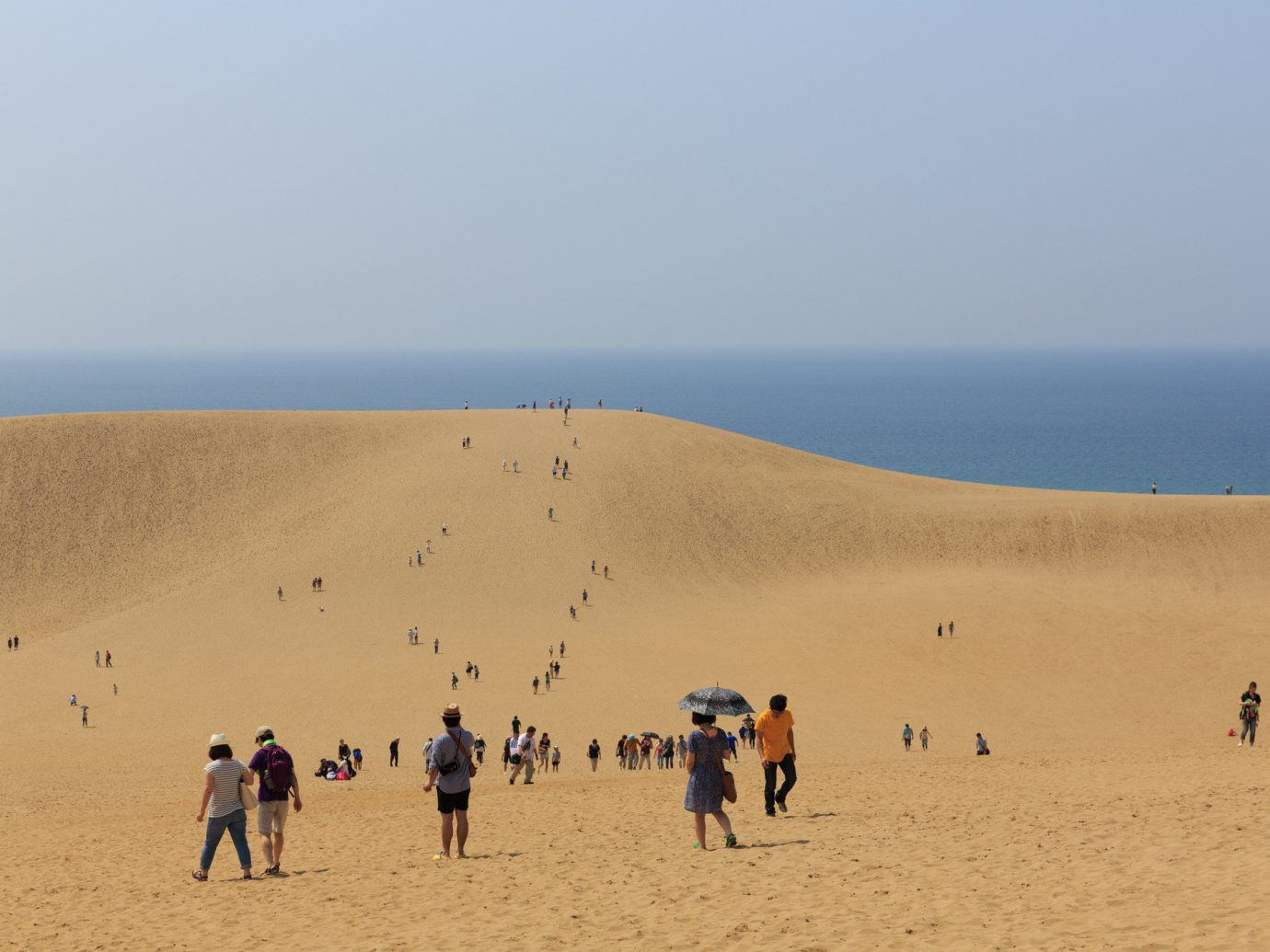 Trip Ideas sky outdoor Nature habitat Beach natural environment dune landform geographical feature erg people sand aeolian landform group sahara shore Sea landscape Desert wadi several