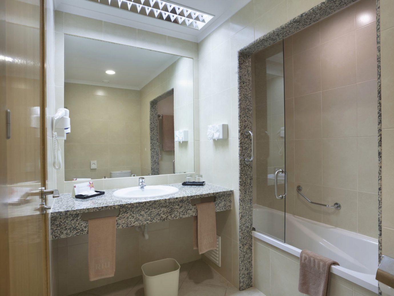 All-Inclusive Resorts Hotels bathroom wall indoor mirror room property sink interior design Suite real estate toilet estate home window tub tile tan bathtub Bath