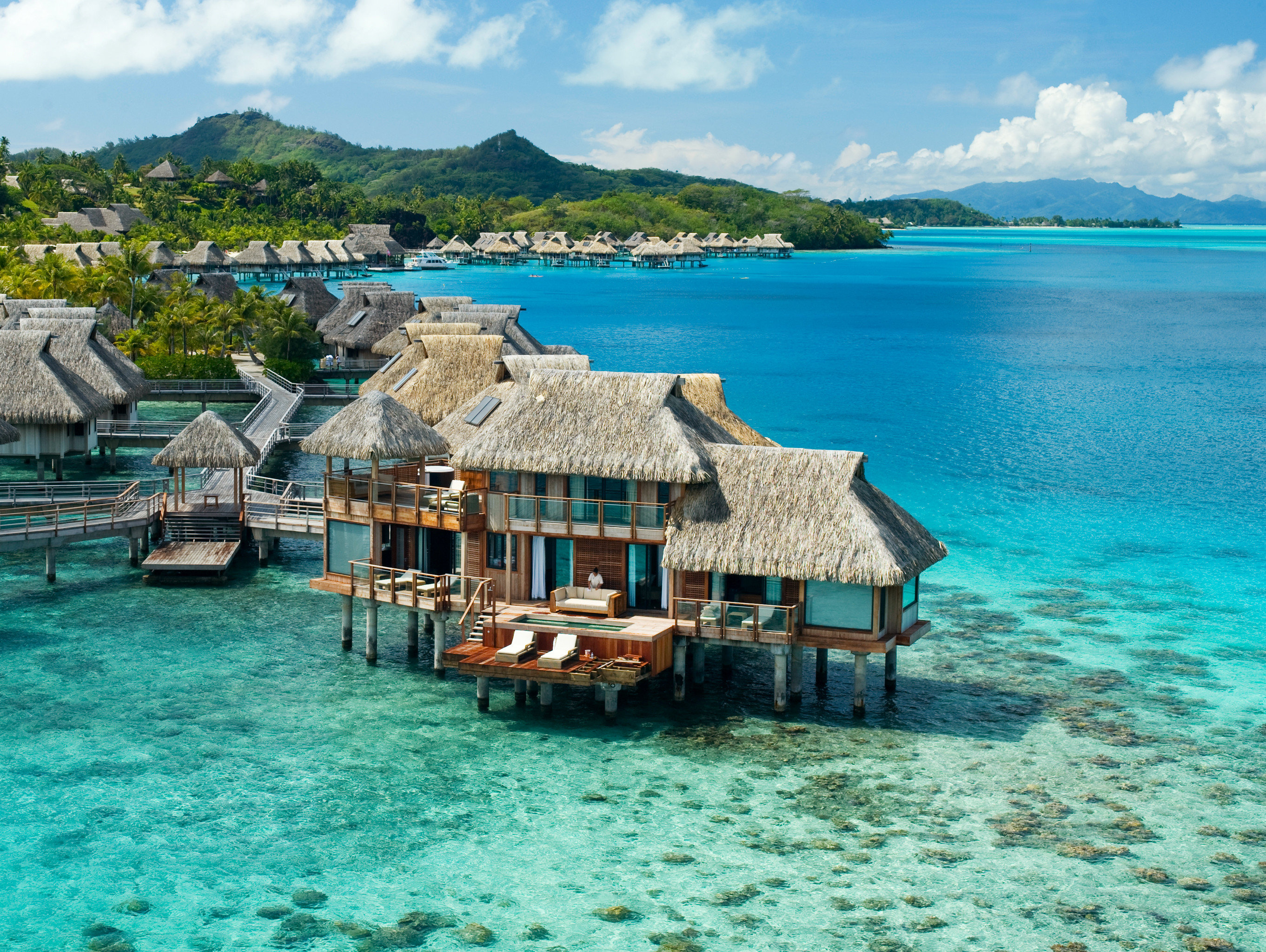 Boutique Hotels Hotels Luxury Travel water sky outdoor mountain Sea geographical feature landform house Boat caribbean body of water archipelago vacation Ocean Beach Coast Island Resort bay Lagoon islet resort town cove blue swimming pool cape tropics Harbor cay overlooking shore swimming