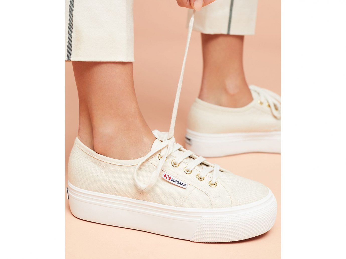 Spring Travel Style + Design Travel Shop footwear person white shoe sneakers product outdoor shoe product design beige walking shoe posing