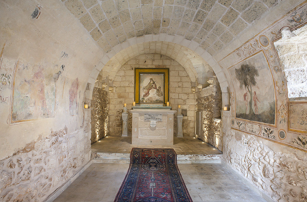 Boutique Hotels Hotels Trip Ideas indoor wall floor stone chapel room ancient history place of worship tourist attraction interior design history historic site ceiling crypt arch Church building religious institute stock photography window decorated
