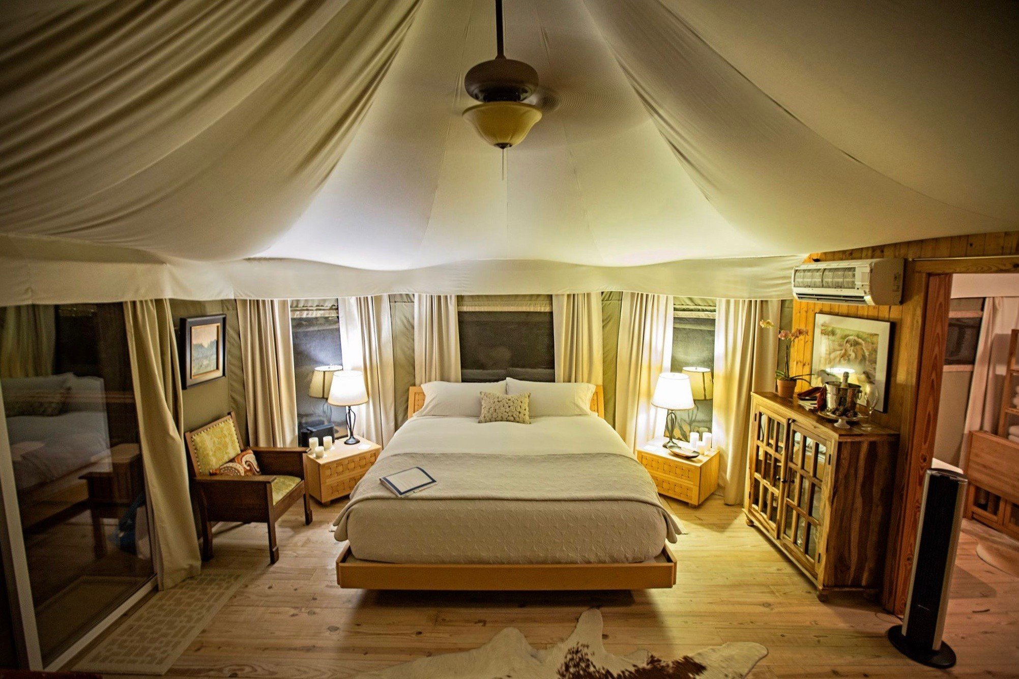 Glamping Outdoors + Adventure Trip Ideas indoor floor ceiling room wall Bedroom property bed estate Suite cottage home real estate interior design Villa Resort mansion living room farmhouse furniture