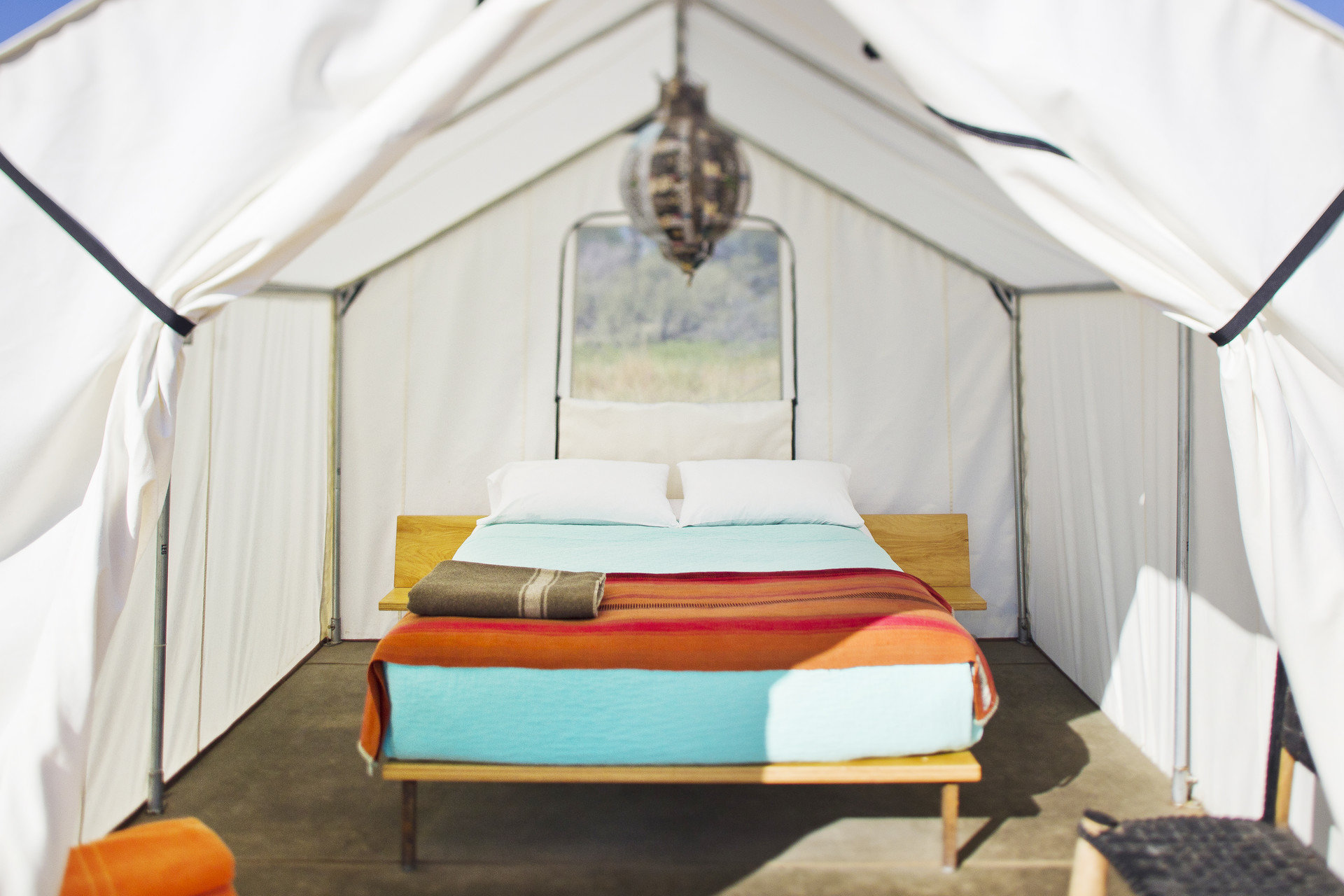 artistic artsy bed Bedroom Glamping Hip interior isolation Luxury Travel quirky remote tent tents trendy Trip Ideas indoor floor room product furniture cottage