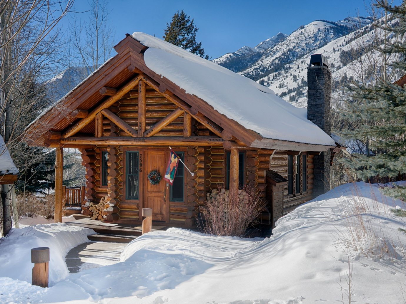 Mountains + Skiing Outdoors + Adventure Trip Ideas snow outdoor tree sky Winter mountain log cabin building weather house hut season home Nature Resort cottage sugar house estate mountain range