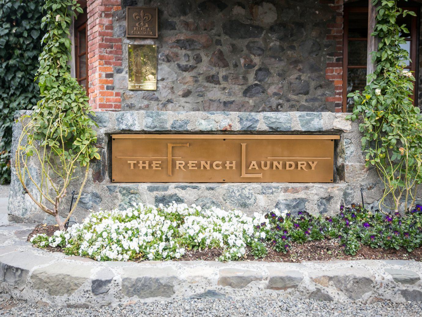 Food + Drink Girls Getaways Trip Ideas Weekend Getaways outdoor ground sign wall Garden yard Courtyard home estate backyard memorial plant stone