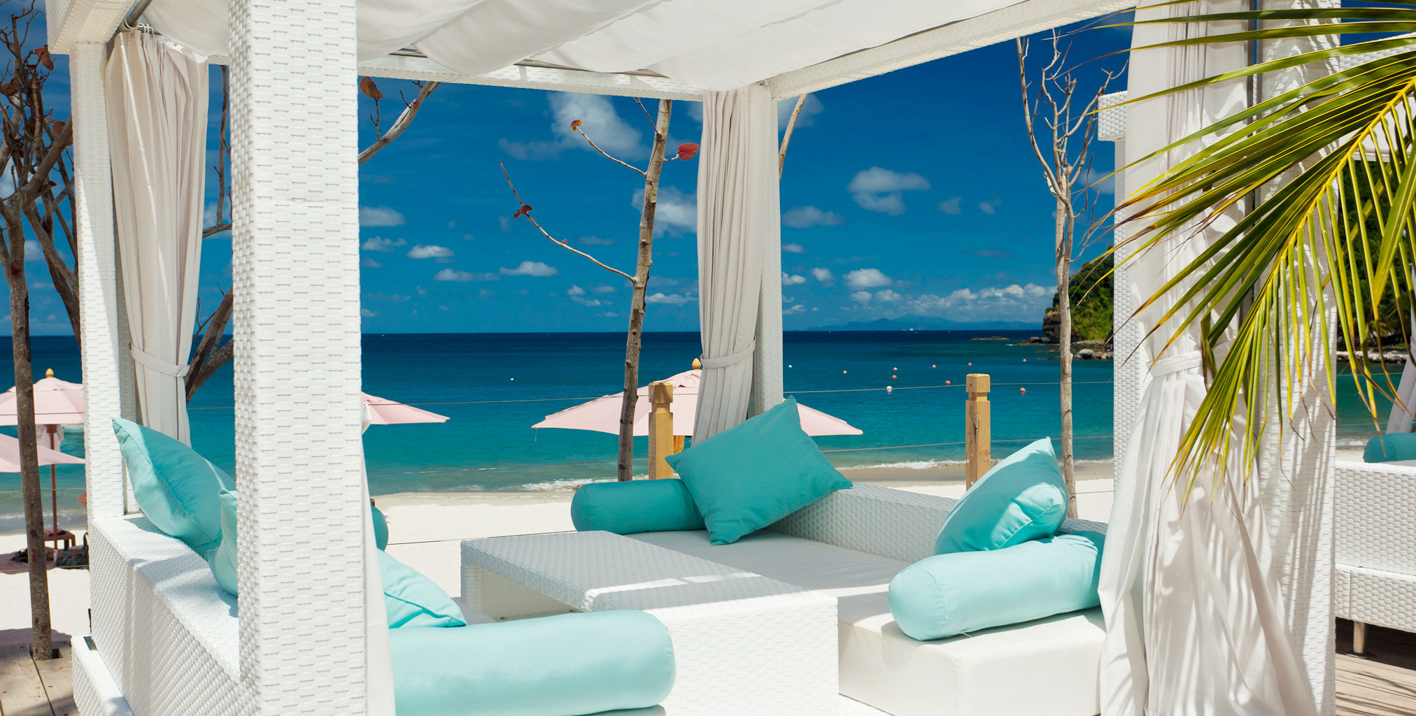 Beach Beachfront Hotels Island Living Wellness blue room chair swimming pool caribbean vacation Resort interior design estate Villa apartment furniture several