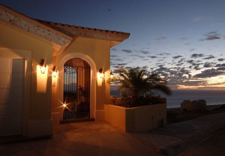 sky building property house light home lighting evening Villa hacienda arch