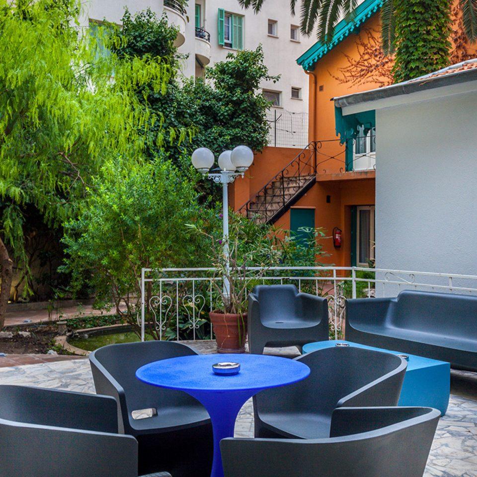 tree property house restaurant home condominium backyard Villa cottage blue