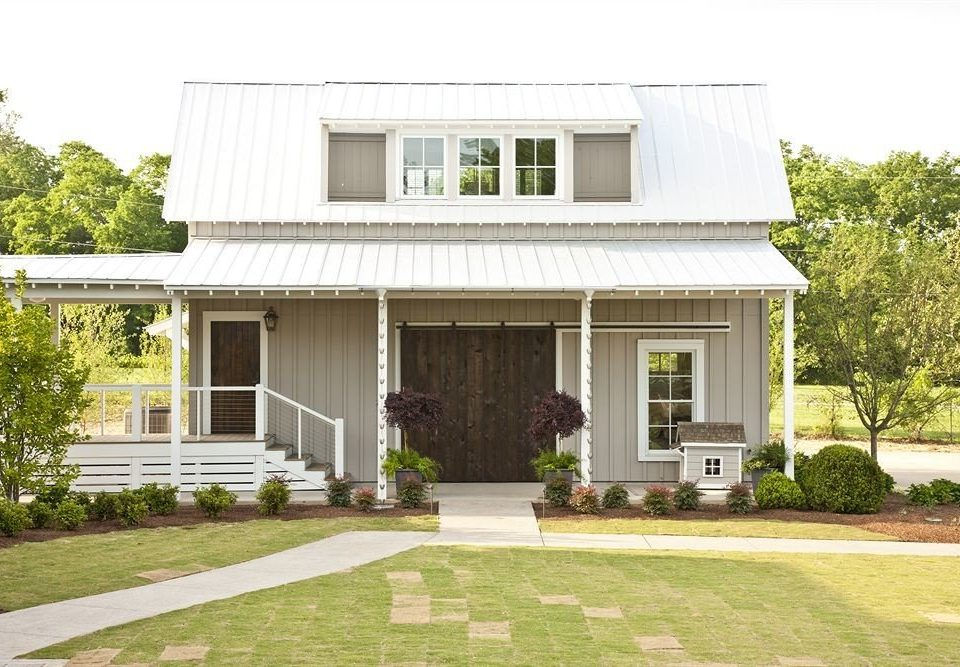 building grass house tree home property siding residential area lawn cottage Villa farmhouse brick backyard porch mansion outdoor structure suburb residential