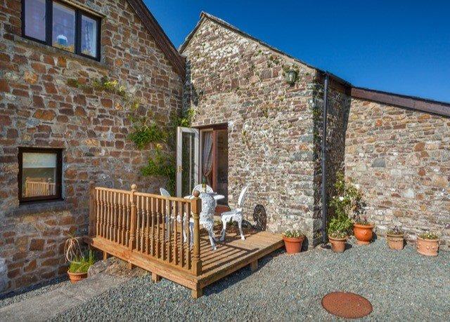 building ground property home cottage brick outdoor structure porch stone backyard Villa