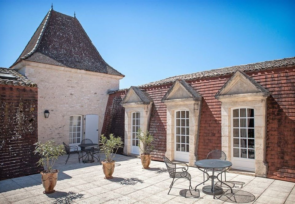 building sky ground property house brick home stone roof cottage farmhouse outdoor structure Villa backyard old building material