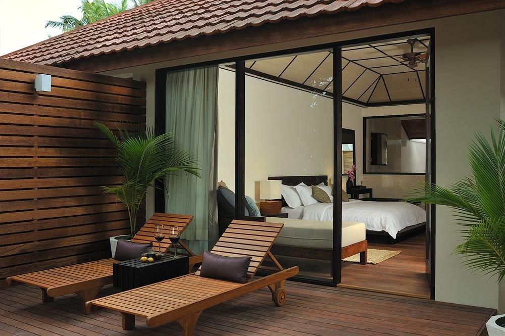 property building living room home hardwood outdoor structure porch condominium cottage Villa backyard
