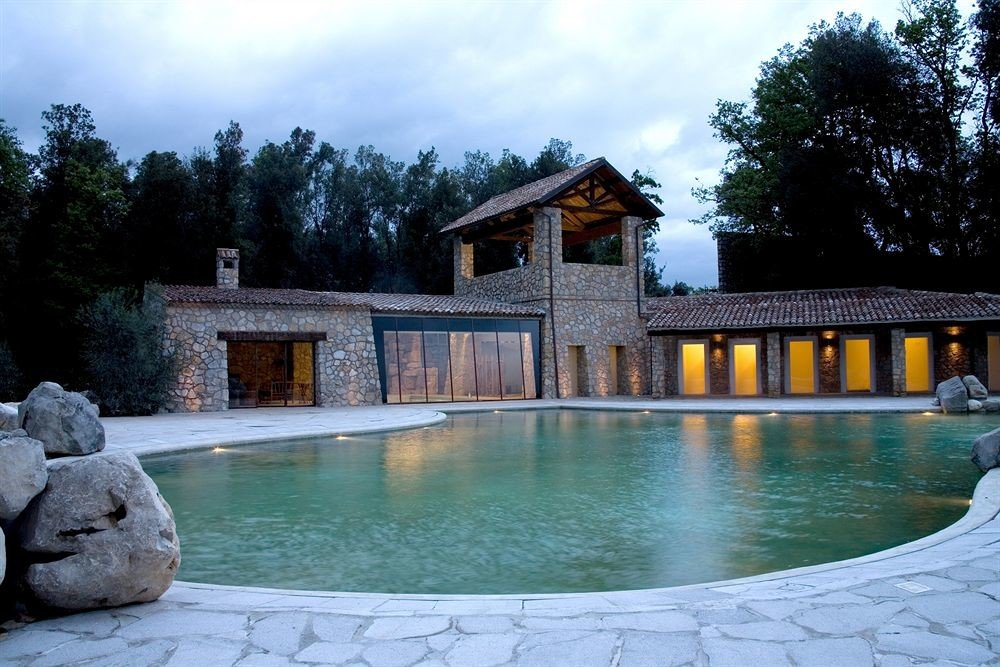 tree swimming pool property house building home backyard Villa mansion cottage stone