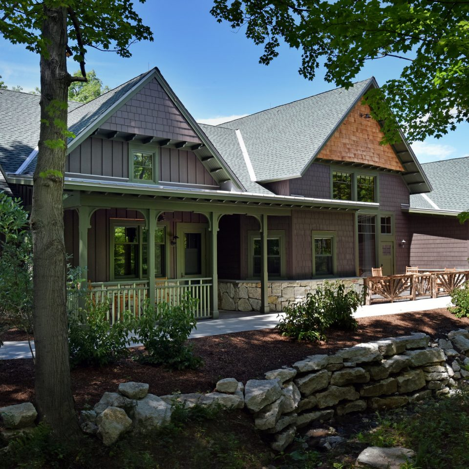 house home property cottage farmhouse residential area outdoor structure siding historic house roof landscape plant tree landscaping mansion backyard Villa building yard elevation