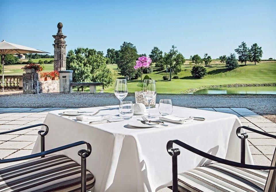 sky property park home Villa mansion cottage backyard empty set dining table