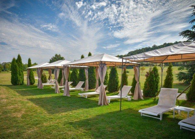 grass sky property gazebo tent backyard home Villa cottage outdoor structure pavilion lush