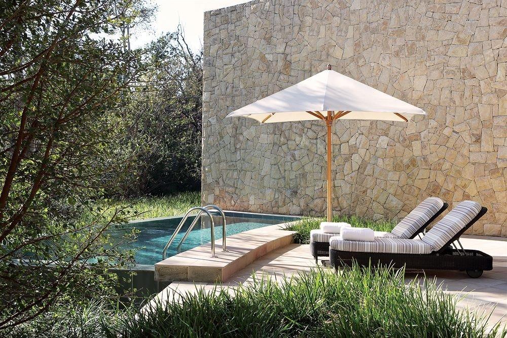 tree backyard outdoor structure swimming pool cottage Villa umbrella