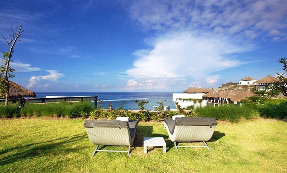 grass sky property field lawn grassy swimming pool Villa home lush bench
