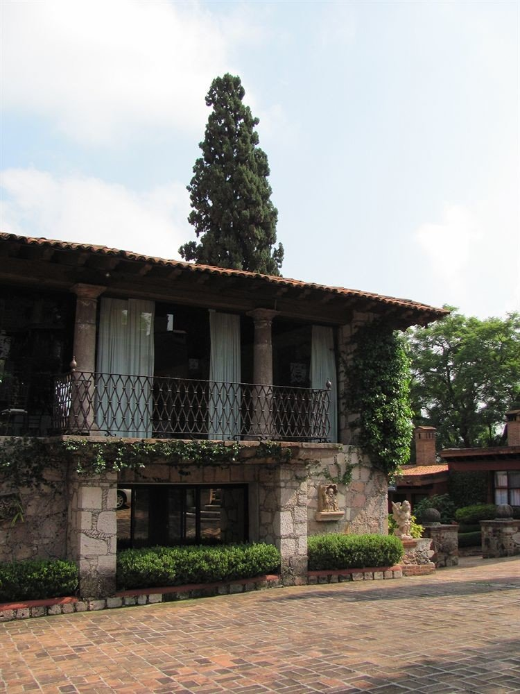 sky building house property home residential area brick stone Villa cottage hacienda mansion