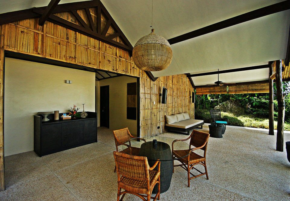 chair property house building home cottage Villa farmhouse hacienda living room