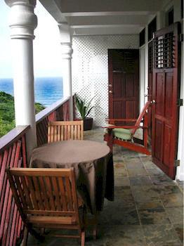 property chair building porch house home cottage hacienda Villa farmhouse outdoor structure mansion