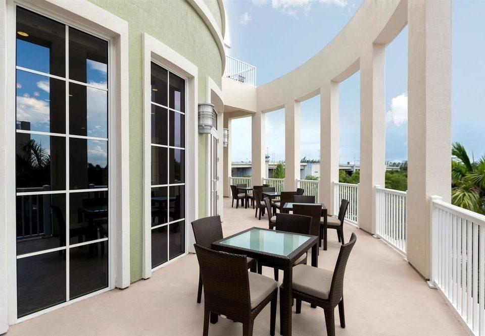 building property condominium porch home Villa living room overlooking colonnade