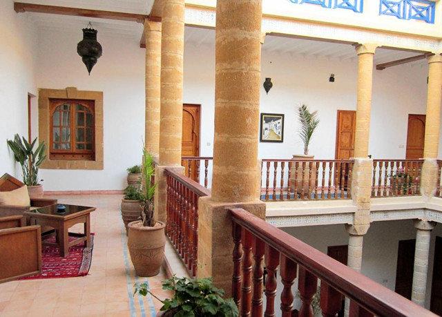 property building home Villa hacienda condominium cottage mansion living room porch farmhouse colonnade