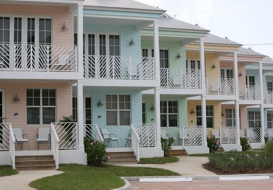 building property house home white condominium residential area porch siding lawn cottage Villa outdoor structure