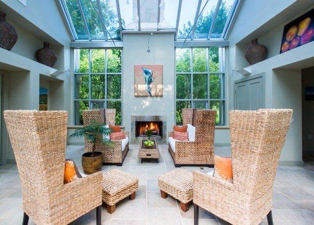 property chair living room home porch cottage condominium outdoor structure Villa farmhouse stone