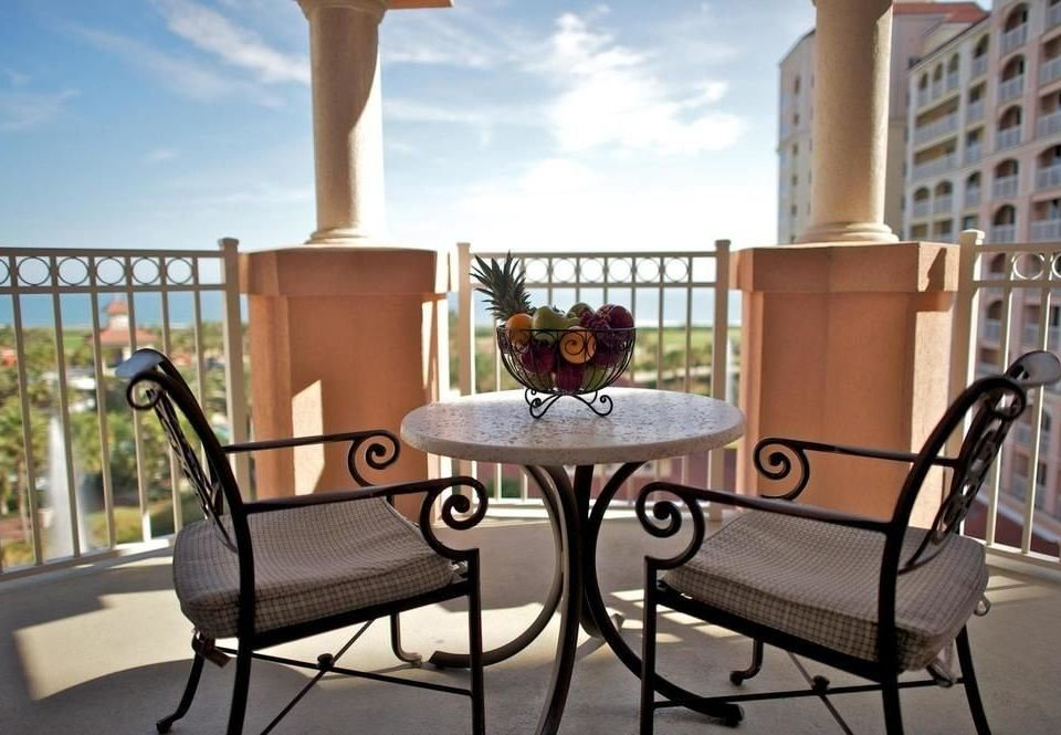 chair property living room home outdoor structure Villa condominium porch dining table