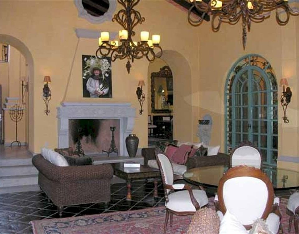 chair property living room home mansion cottage Villa hacienda dining table