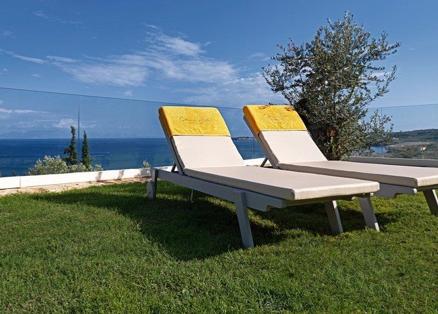 grass sky sunlounger outdoor furniture lawn overlooking Villa chair grassy seat