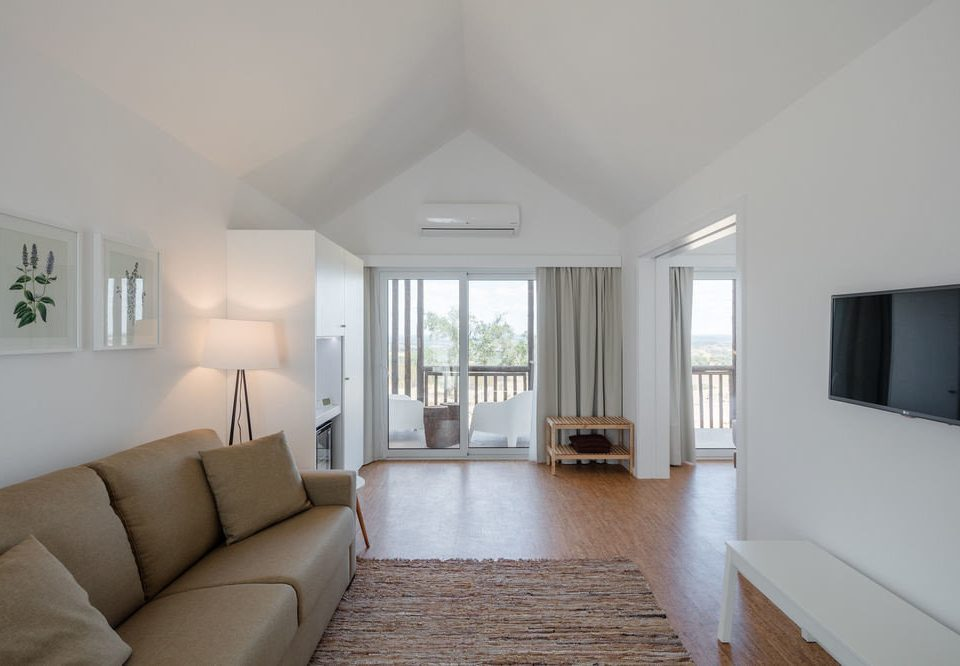 sofa property living room house home condominium cottage Villa daylighting flat