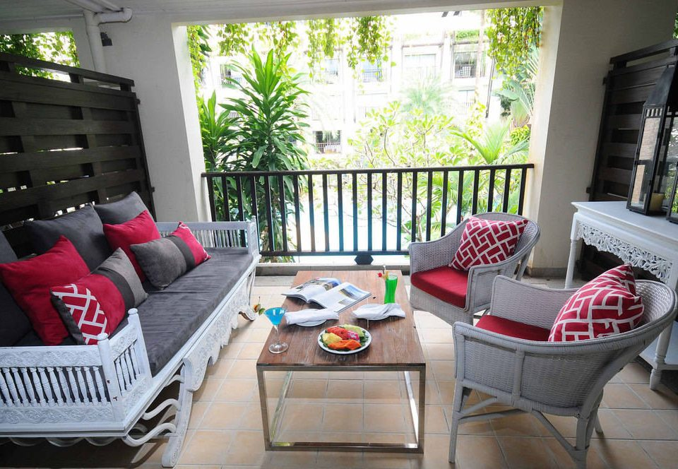 living room property home porch condominium cottage outdoor structure Villa dining table
