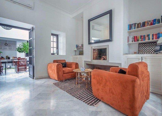sofa property living room home condominium hardwood cottage Villa orange flooring