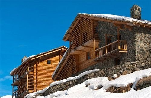 building sky snow property rock roof house cottage home Villa stone Village old
