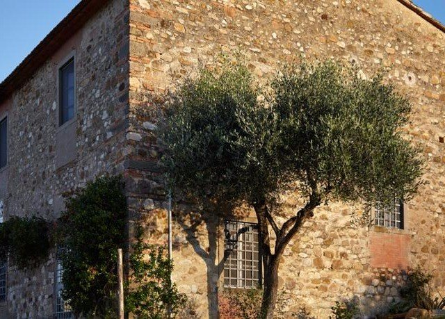 building tree property brick house home cottage Village stone tower